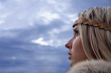 Viking girl on a dark sky background