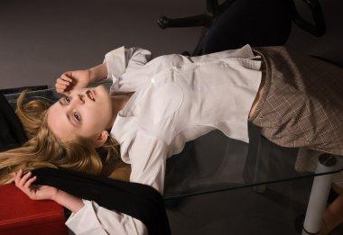 Lifeless girl lying on a table