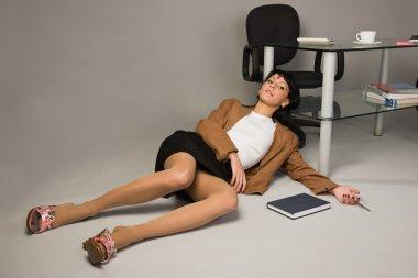 Lifeless businesswoman in a office