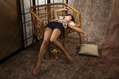 Brunette asleep in a luxury boudoir