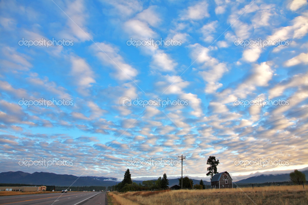 Picturesque clouds above the American road