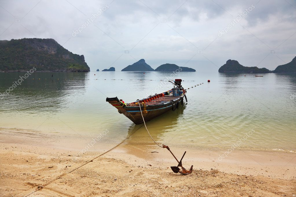 Thai Longtail boat moored on a sandy beach