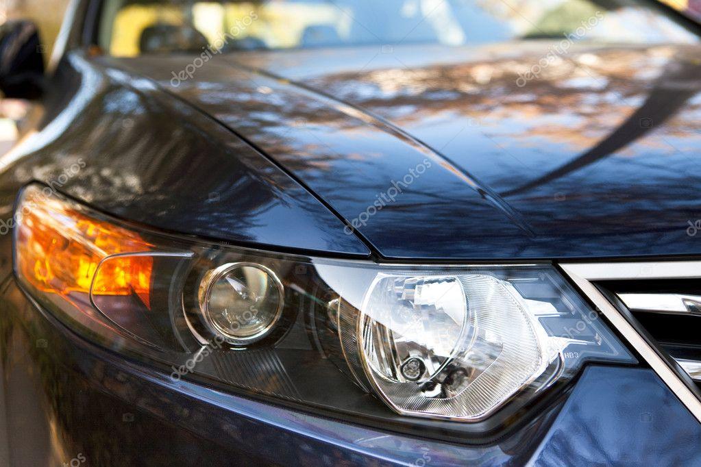 Aggressive looking, car headlight closeup