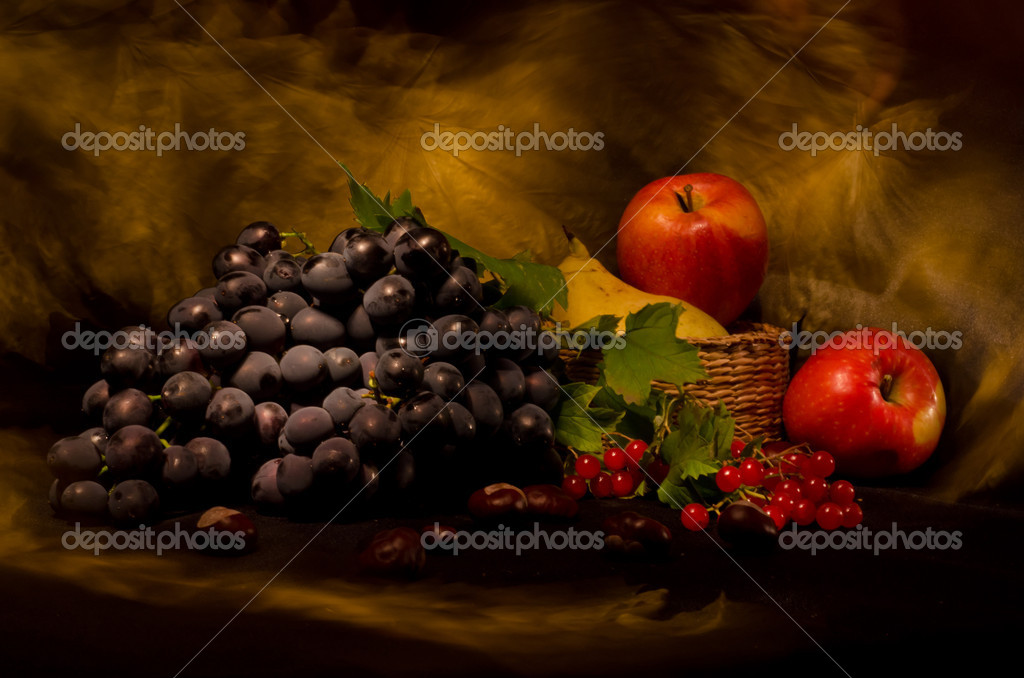 Still life with autumn vegetables and fruits on black background