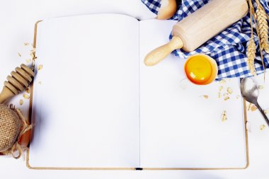 Open notebook and Basic baking ingredients