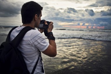 Travel photographer with digital camera