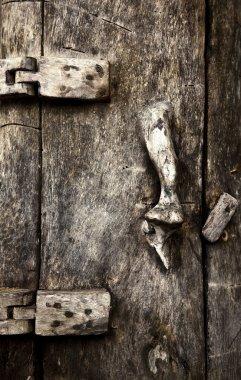 Old wooden door with ornaments In Bali.