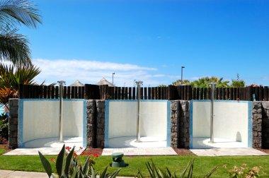 Outdoor showers near swimming pool and beach, Tenerife island, S
