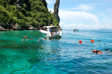 KOH PHI PHI, THAILAND - SEPTEMBER 13: Snorkeling tourists on tur