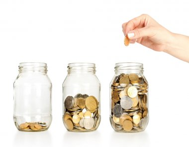 Glass banks for tips with money like diagram and hand