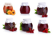 Photo Set of jars with berry jam isolated on white