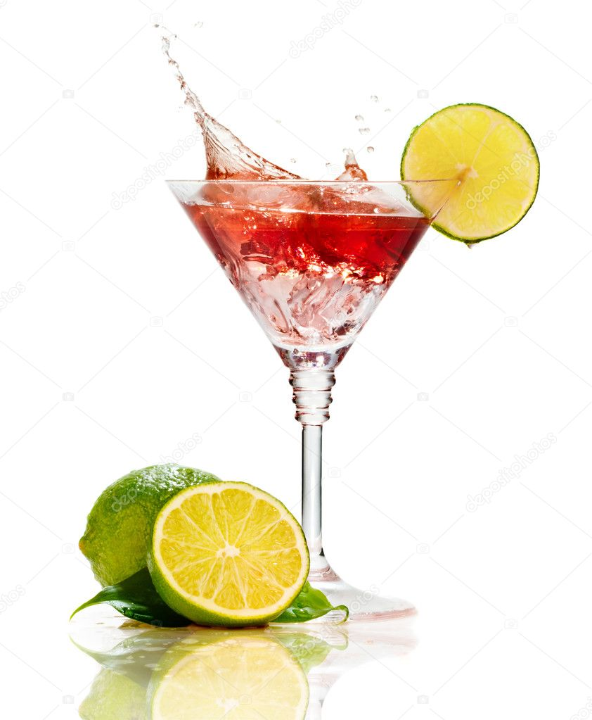 Red martini cocktail with splash and lime isolated
