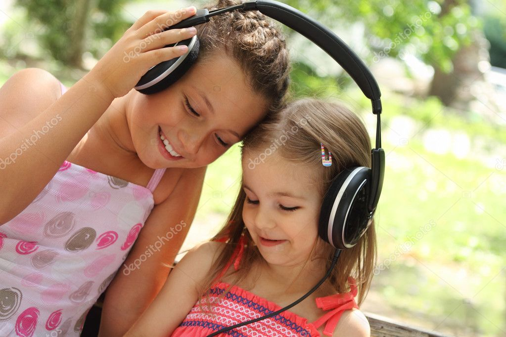 Sisters listen to the music together