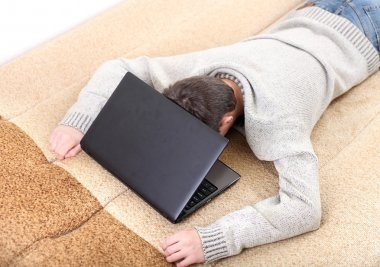 Teenager sleeping with notebook
