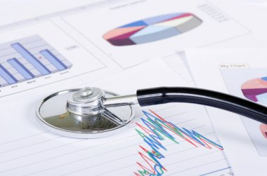 Stethoscope on a stock chart - market analysis