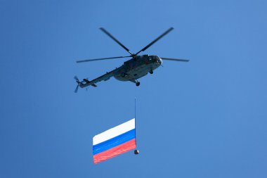 Helicopter in the skies carrying Russian flag