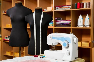 Fashion designer studio with dressmakers professional equipment