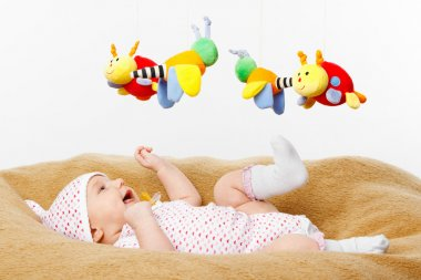 Happy smiling Baby Playing with toys