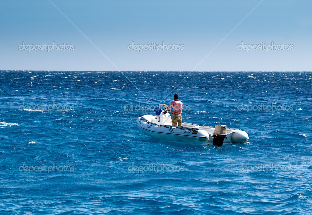 The man in a boat on the sea