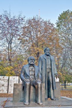 Statue of Karl Marx and Friedrich Engels, authors of The Communist Manifesto of 1848 and regarded as the founders of the Communist movement at Berlin, Germany stock vector