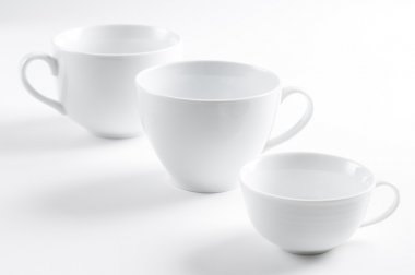Three different white cups