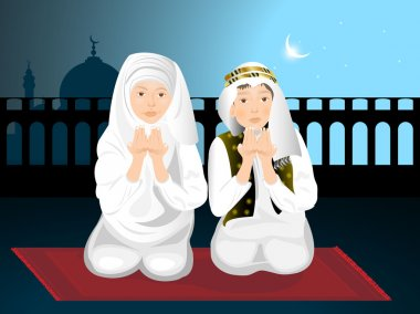 Two cute little muslim kids praying with hands up