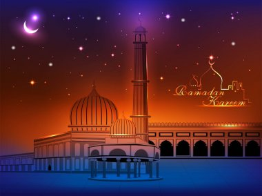 Ramadan Kareem text with Mosque or Masjid on night abstract background in blue color