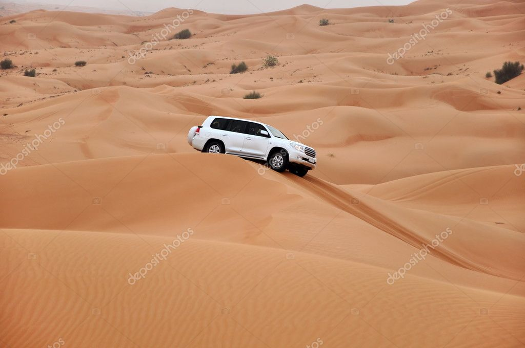 Jeep safari in the sand dunes of the arabian desert