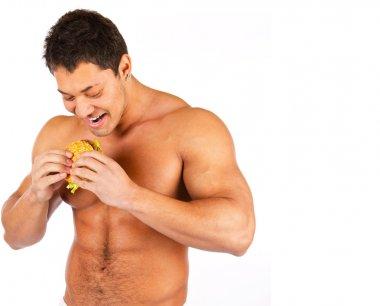 Man eating hamburger over white