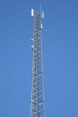 Cell phone tower against a blue sky stock vector