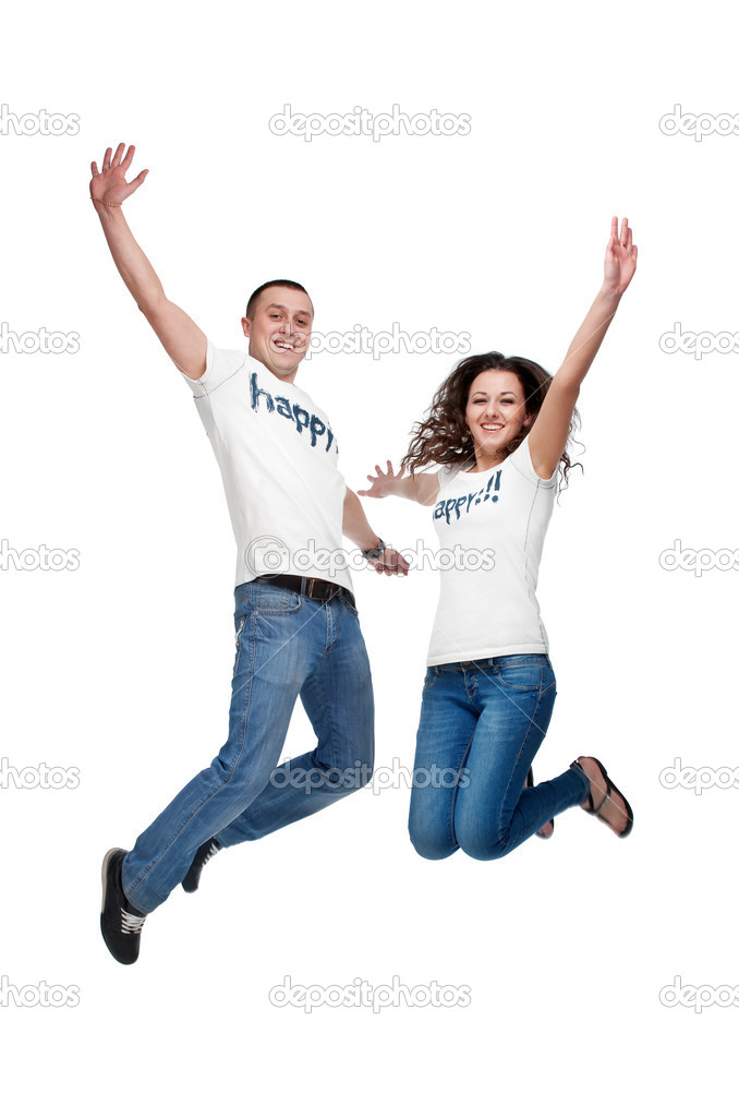 Young happy couple jumping up