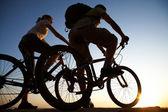 Fotografie paar auf Fahrräder