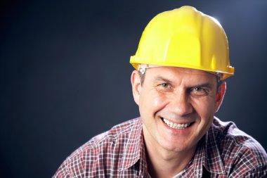 Builder on a dark background