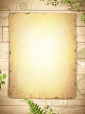 Grunge burnt paper at wooden background