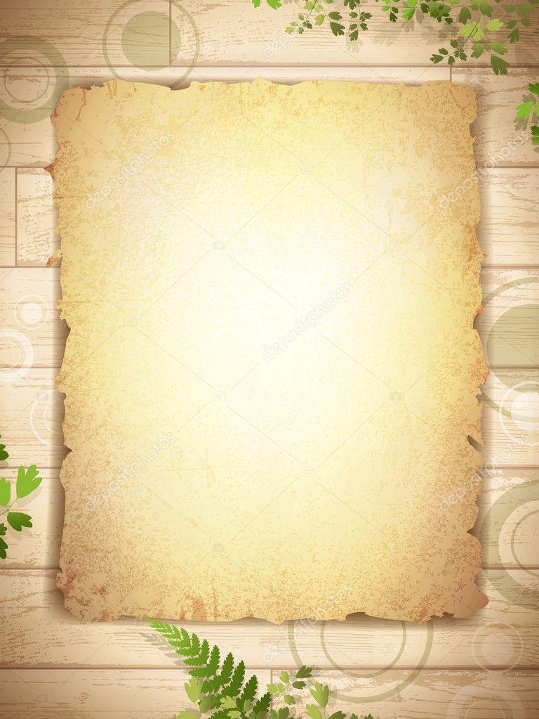 Grunge burnt paper at wooden background