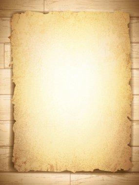 Vintage grunge burnt paper at wooden background