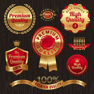 Set of golden quality labels and emblems clip art vector