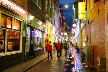 Bars and coffee shops on the night streets of Amsterdam.