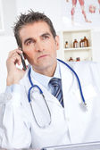 Photo Male Doctor Using Mobile Phone