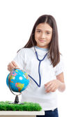 Photo Girl with Stethoscope and Globe