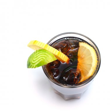 Cocktail - alcohol drink with cola, ice and lime isolated