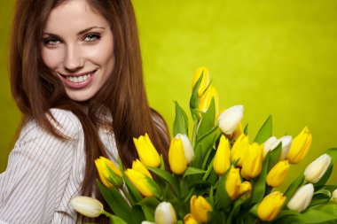 Woman with colorful tulip bouquet