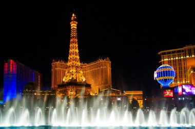 The Musical fountains on Eiffel Tower of Hotel Paris background
