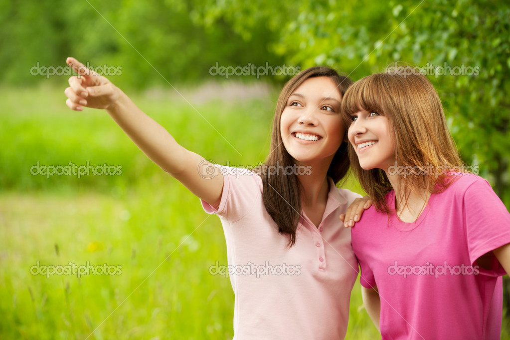 Two young pretty girls in a park