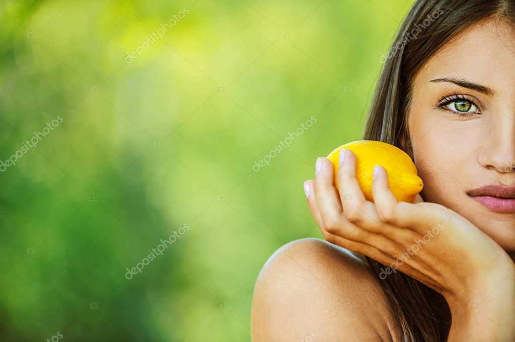 Woman with bare shoulders holding lemon yellow