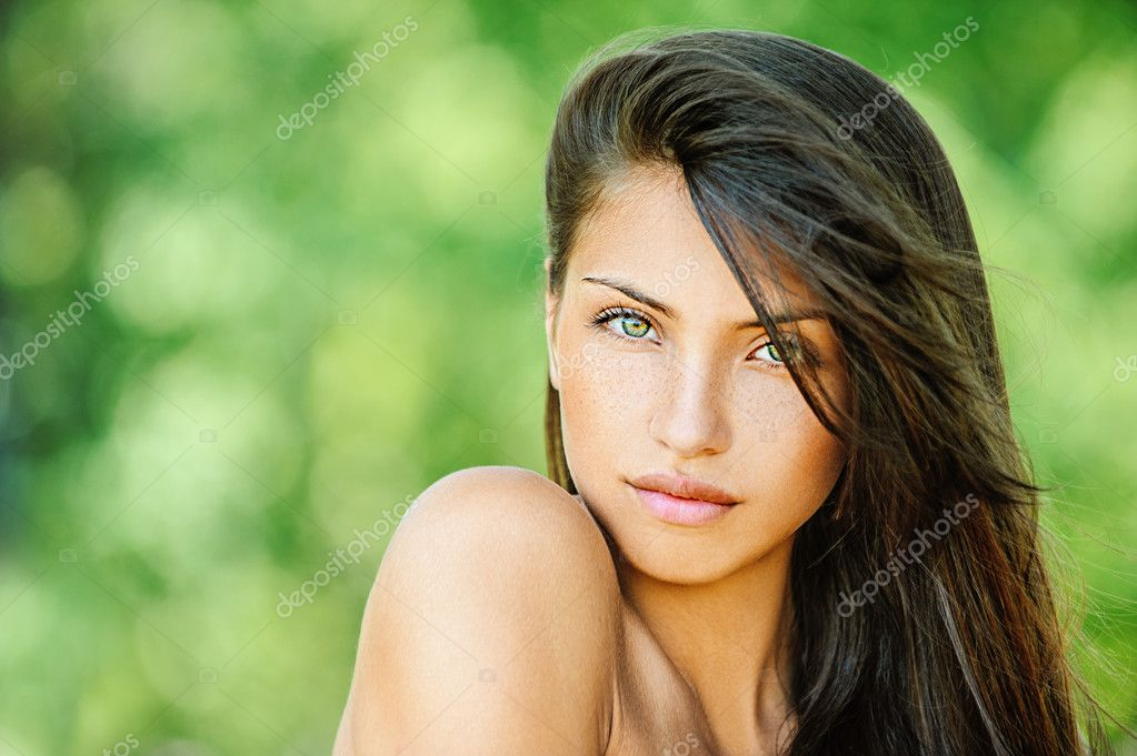 Young beautiful woman with bare shoulders