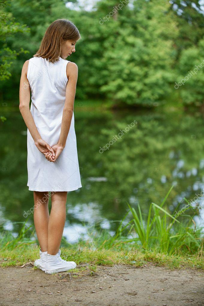 Young woman near lake