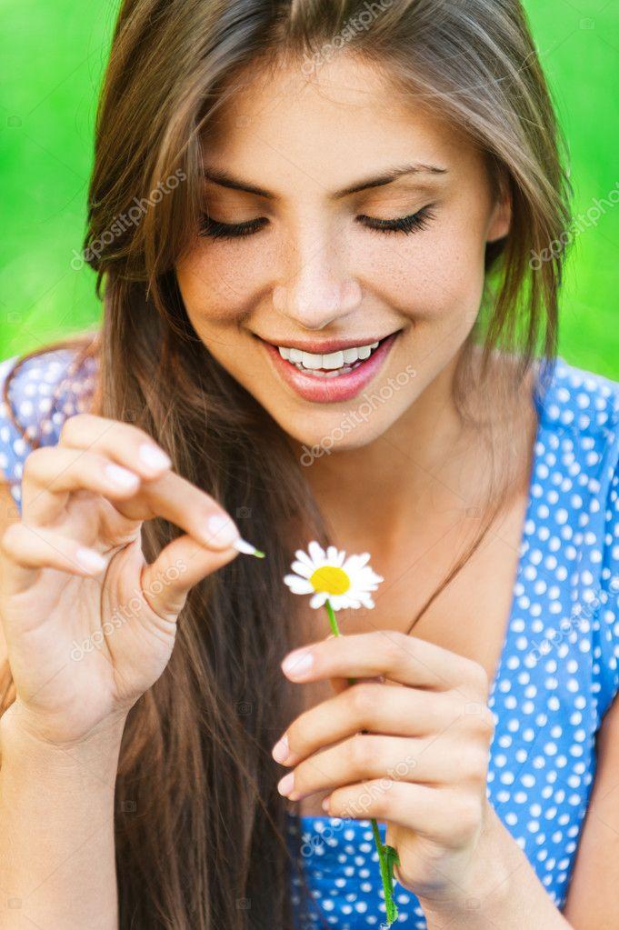 Woman wonders on flower