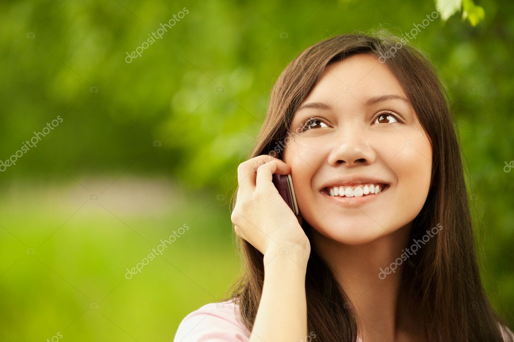 Asian girl talking at the cell phone