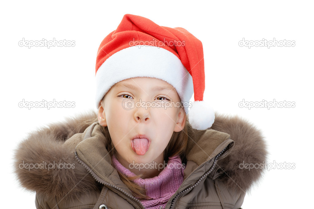 79b856bf6f1a Little girl in Christmas hat show tongue — Stock Photo ...